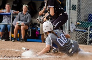 Kyrae Kogaines slides into home