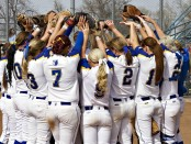 Bruins softball team huddles together