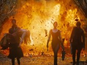 Still from Hansel and Gretel: Witch Hunters featuring the heroes played by Jeremy Renner and Gemma Arterton walking from an explosion.