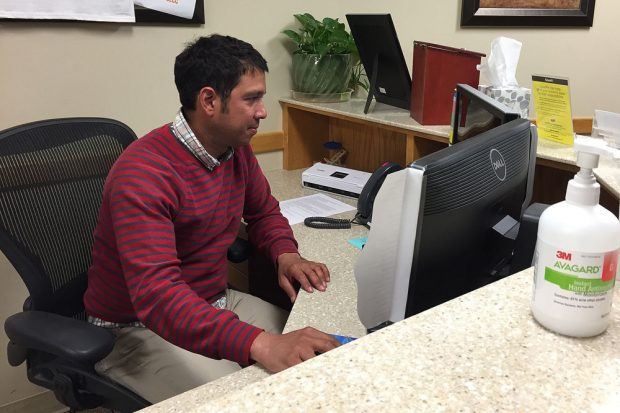 Rogel Fuentes at the front desk