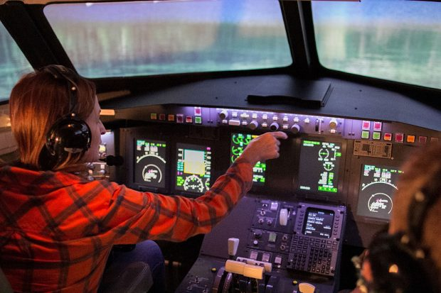 Mindy Relyea pilots simulator