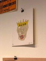 SLUG skull crowned