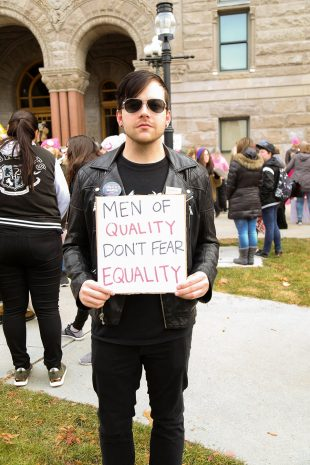 Man holding equality sign