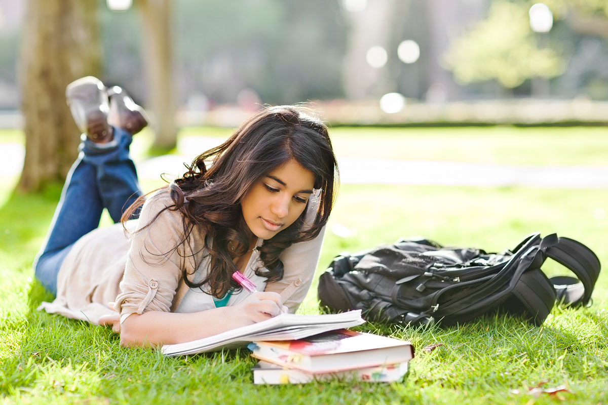 Asian student studying on campus