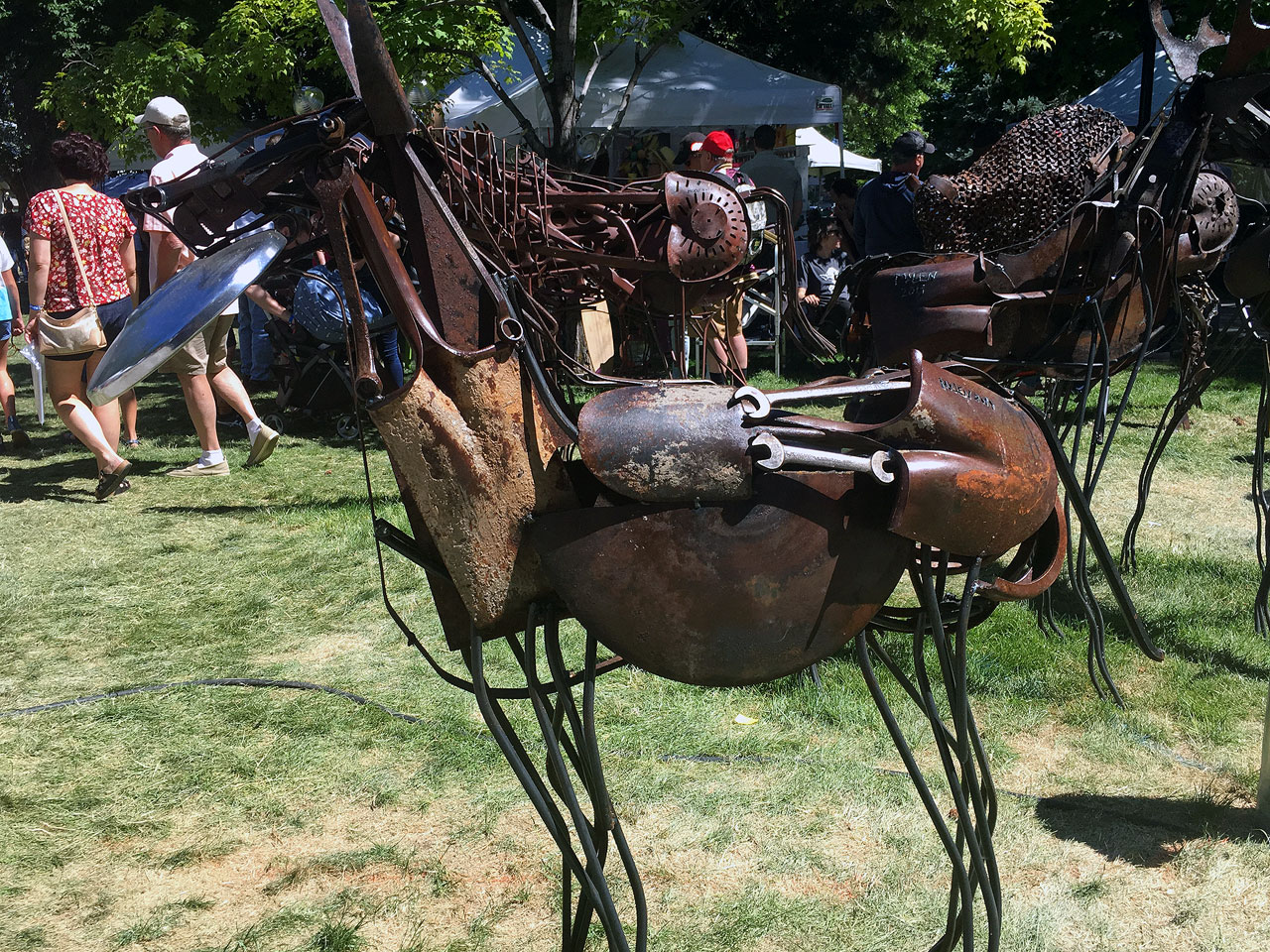 A metal sculpture made of farm tools