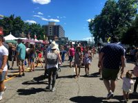 Festivalgoers walk down the street