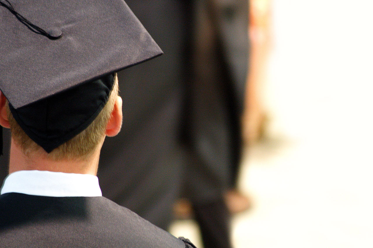 Young man wearing cap and gown