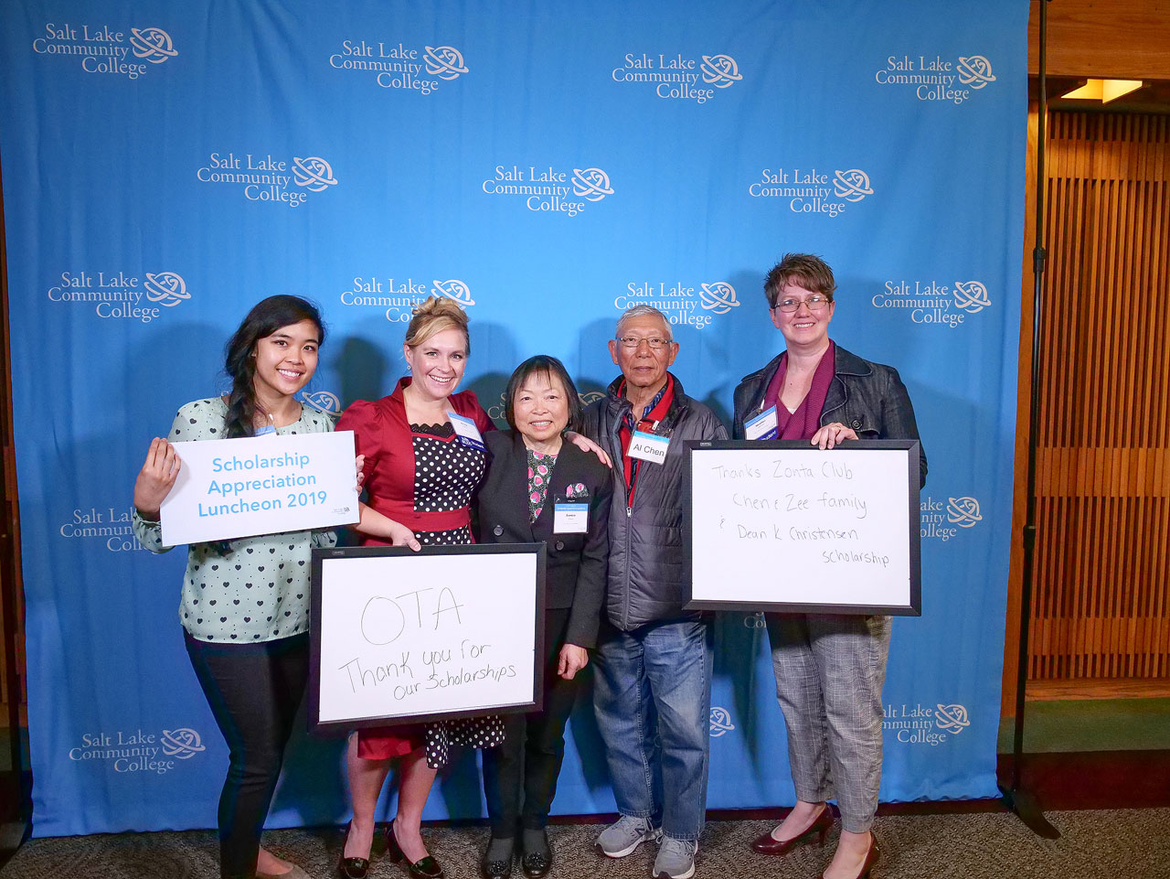 Eunice Chen, center, and Al Chen, second from right, with three scholarship recipients