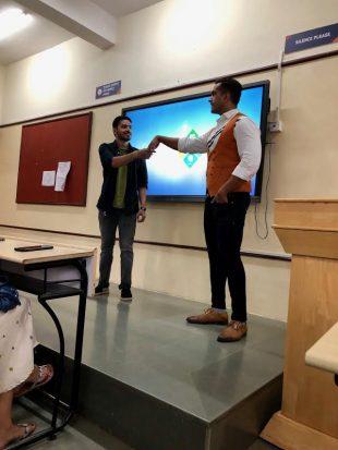 Chetan Agarwal demonstrates a handshake