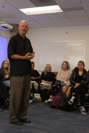 Norm Zurn addresses his students
