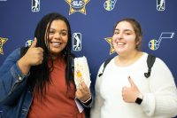 Hannah and Kayla give a thumbs up at the fall job fair