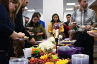 Guests sample fruit and vegetable trays