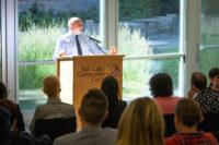 Charles Lepper speaks from a podium
