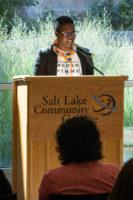 Thando Naluyima speaks from a podium