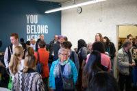Dozens of people talk inside the GSSRC