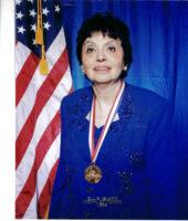 Inge Auerbacher wears her Ellis Island Medal of Honor