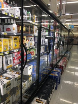 Grocery store aisle full of 5% by volume beer