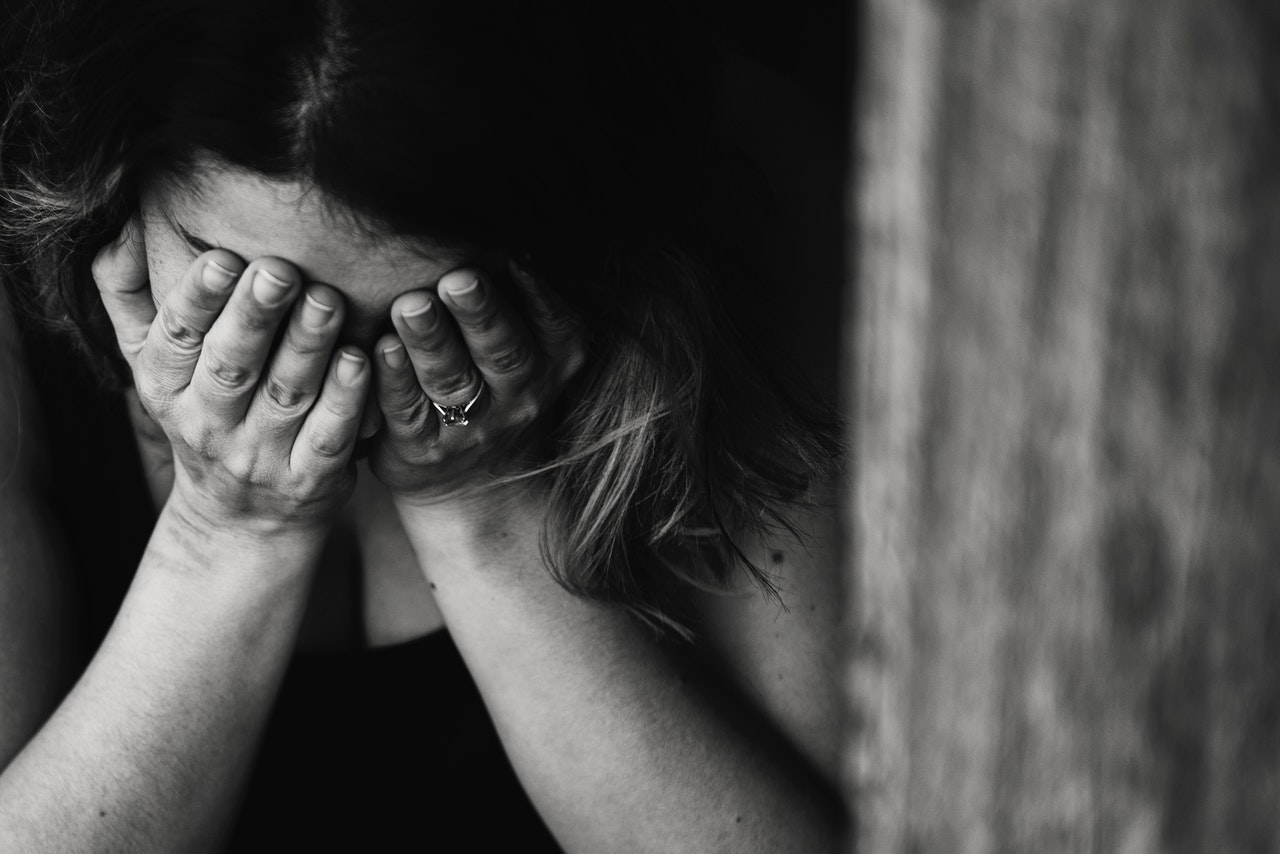 Grayscale photo of crying woman