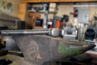 Hammer resting on a Vulcan anvil