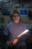 Richard holds a lit Oxy/Fuel torch
