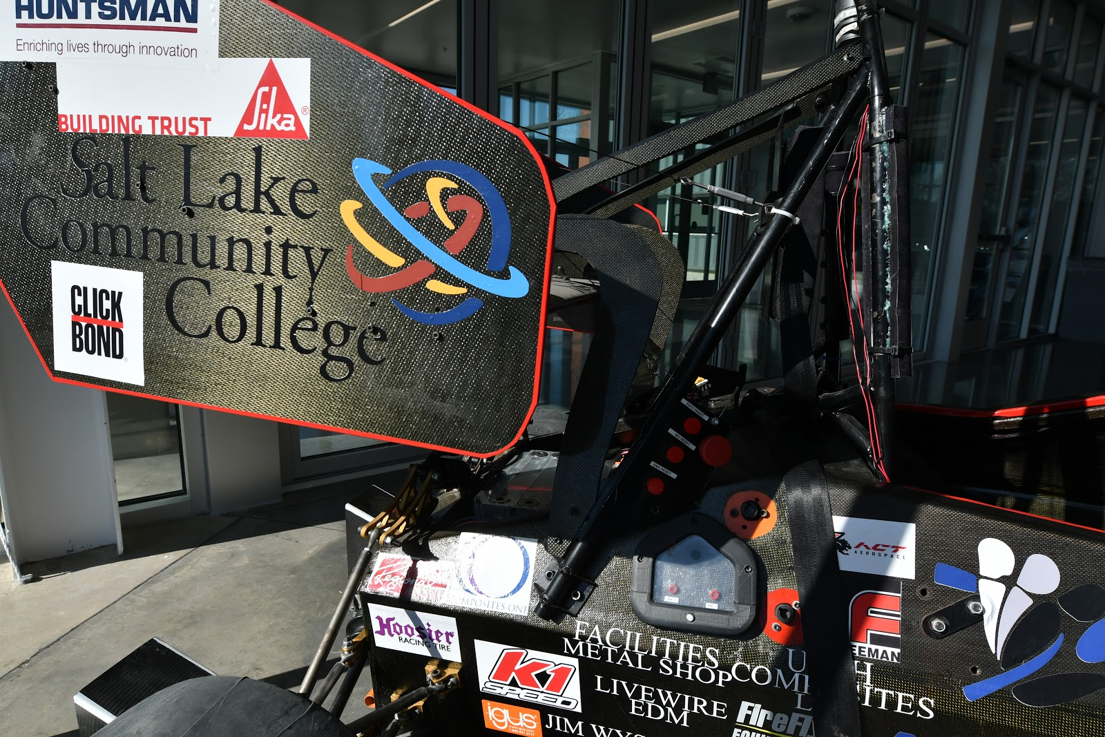 SLCC logo on wing of electric car