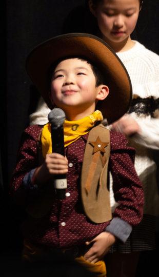 Alan S. Kim holding a microphone