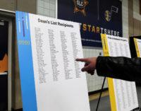 Hand pointing to Dean's List recipients