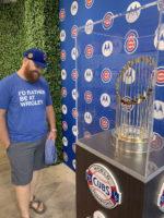 Brian admires World Series trophy behind glass
