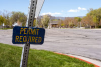 Permit required sign in front of empty parking lot