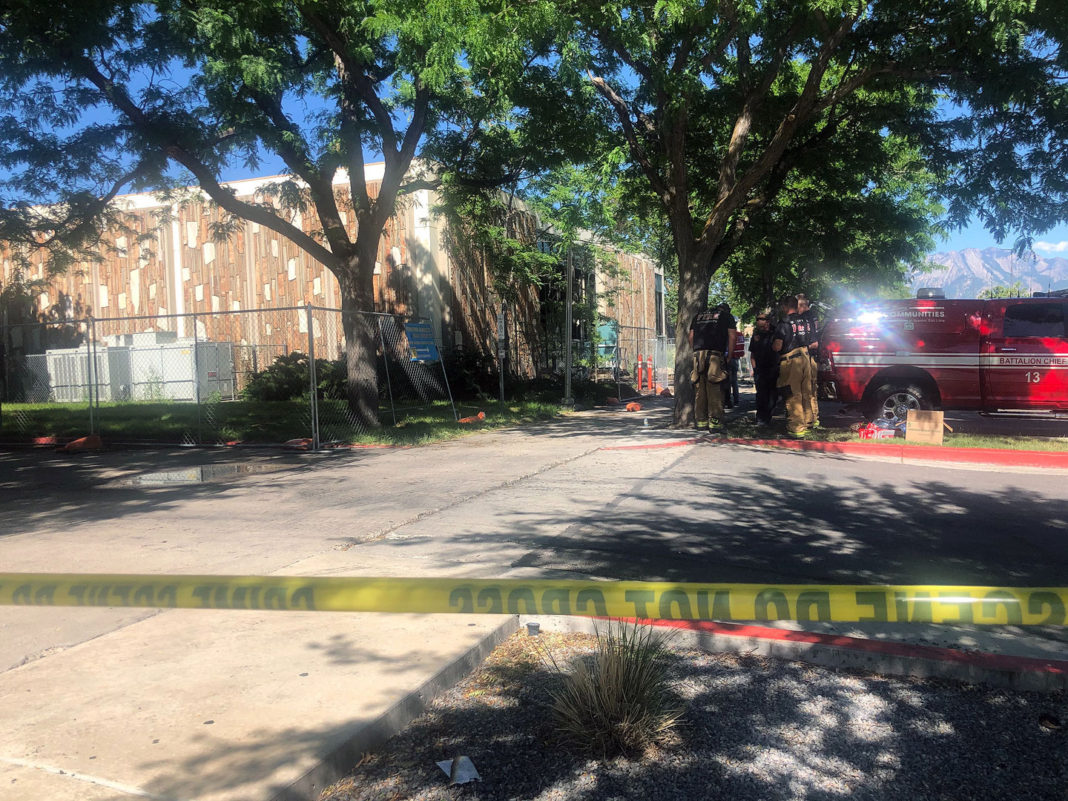 Crime scene tape restricts access to fire cleanup