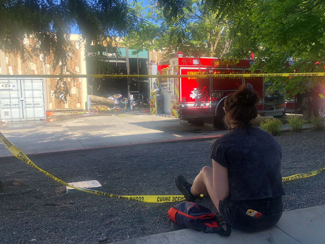 Rachel Tonkovich observes burned-out building
