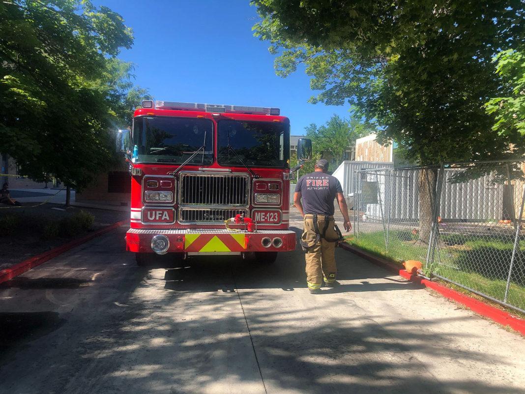 Firefighter walks to fire truck