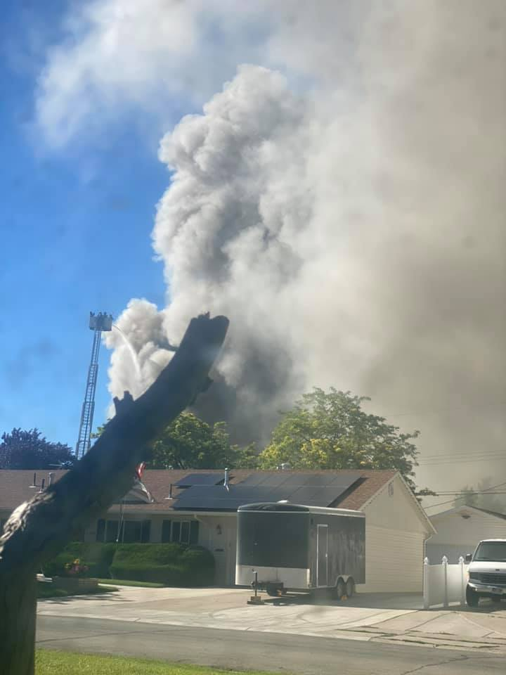 Gray smoke fills neighborhood