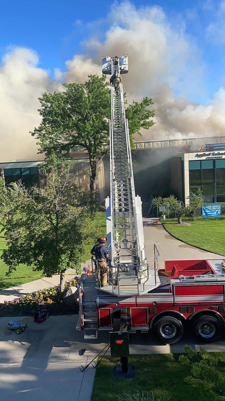 Firefighters climb ladder truck
