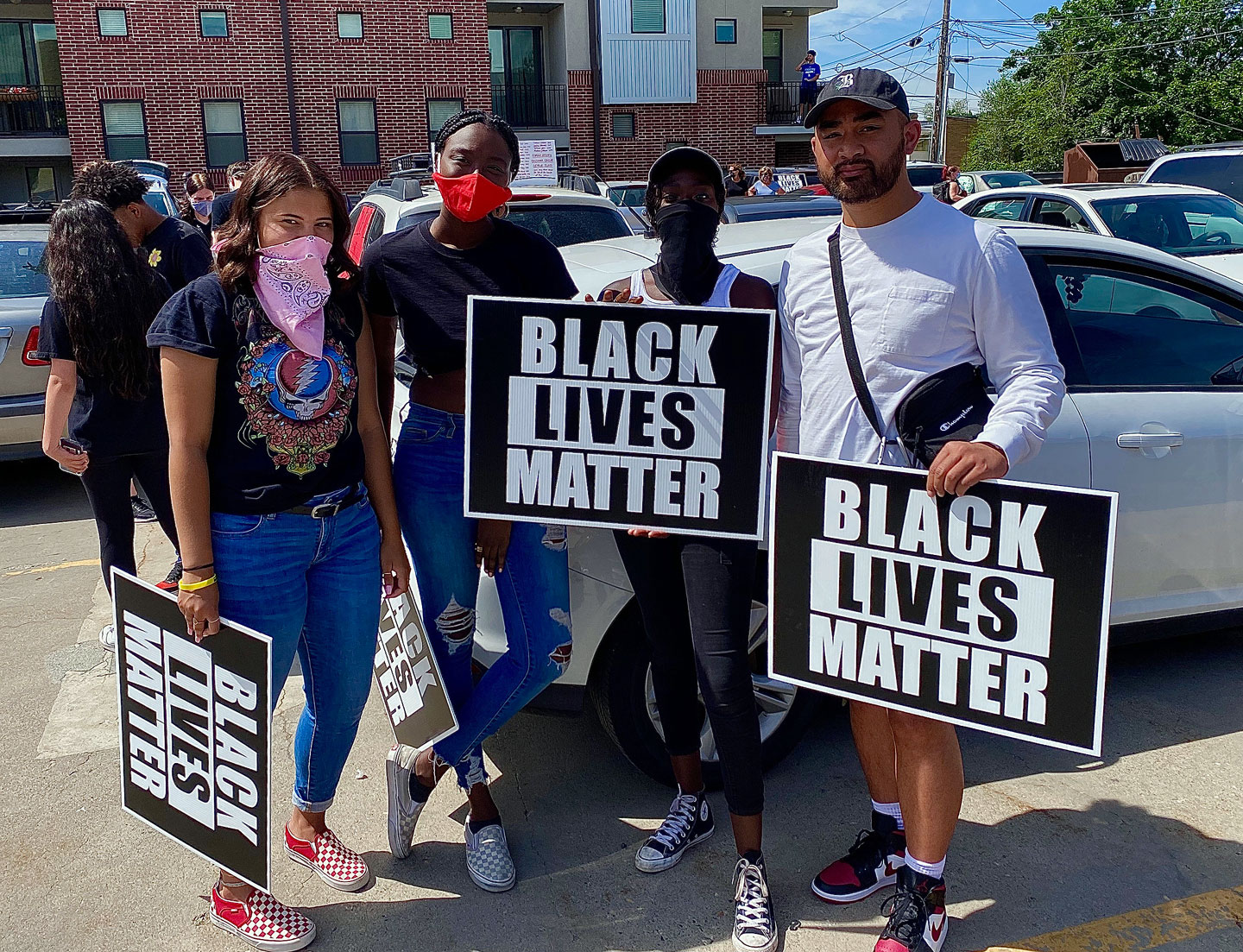 """Protesters hold """"Black Lives Matter"""" signs"""
