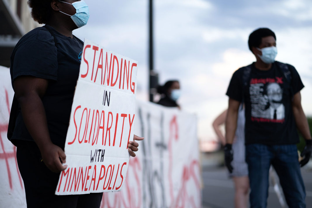 "Sign reads ""Standing in solidarity with Minneapolis"""
