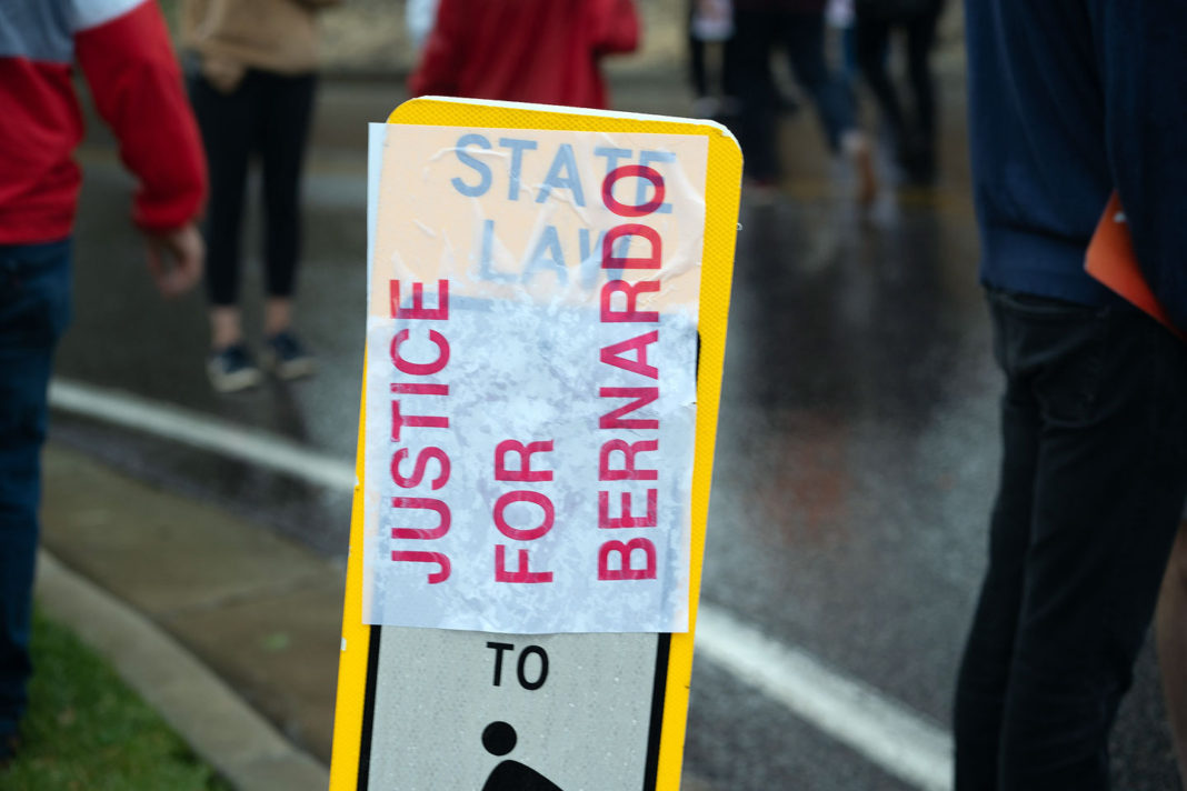 """Justice for Bernardo"" poster covers street sign"