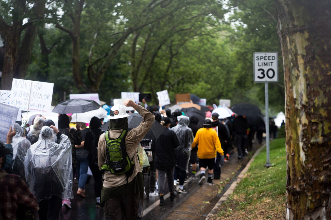 Rain-soaked protesters march in solidarity