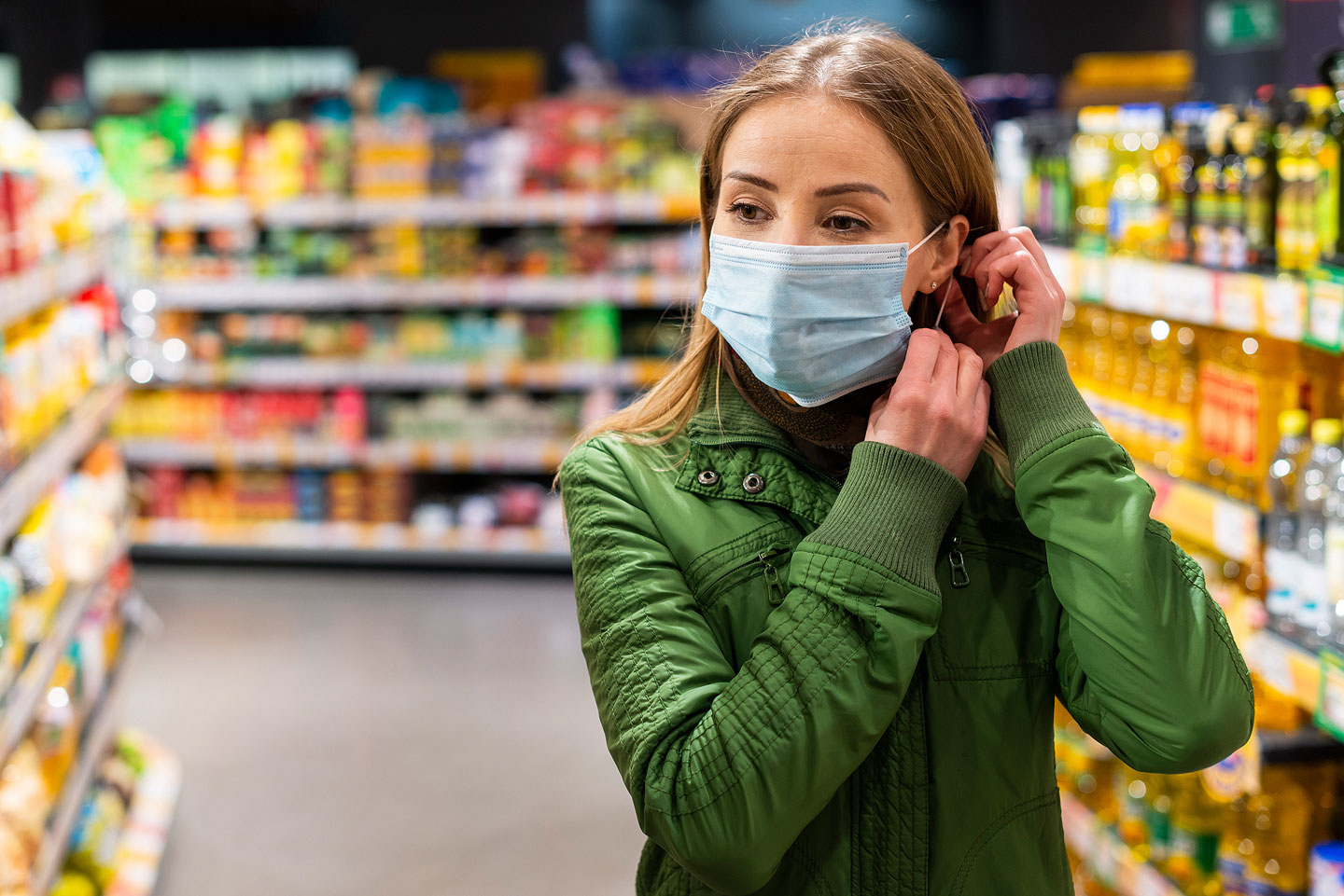 Woman wearing mask in a store