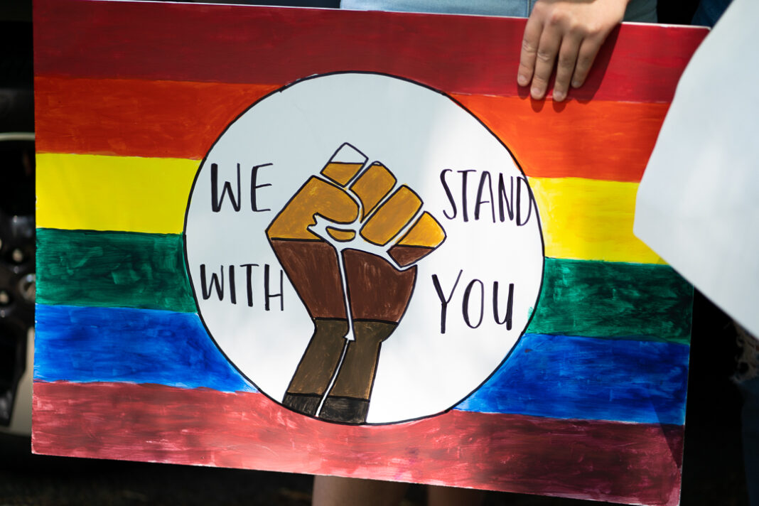 """Sign reads """"We stand with you"""""""
