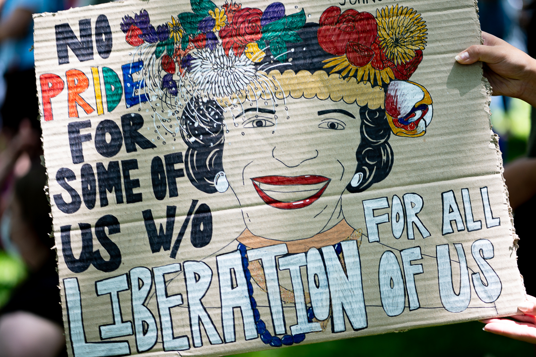 """SIgn reads """"No Pride for some of us w/o liberation for all of us"""""""