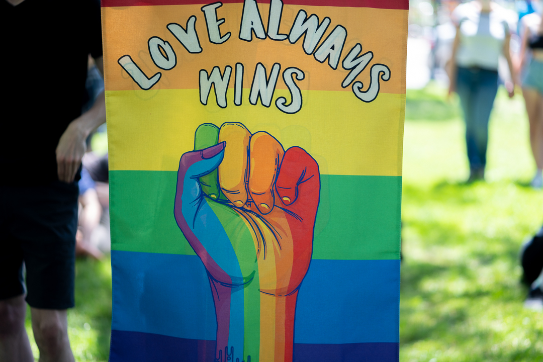 "Sign reads ""Love always wins"""