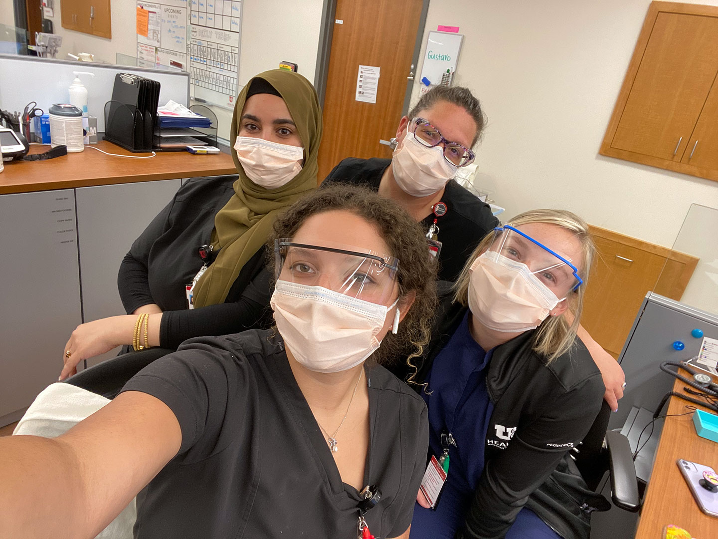 U. pediatric team wearing face coverings