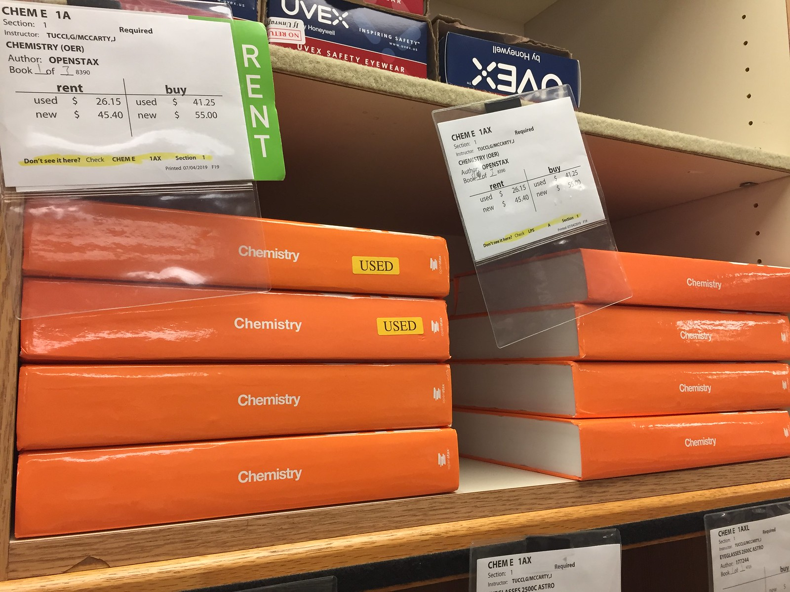 New and used chemistry textbooks stacked on a shelf