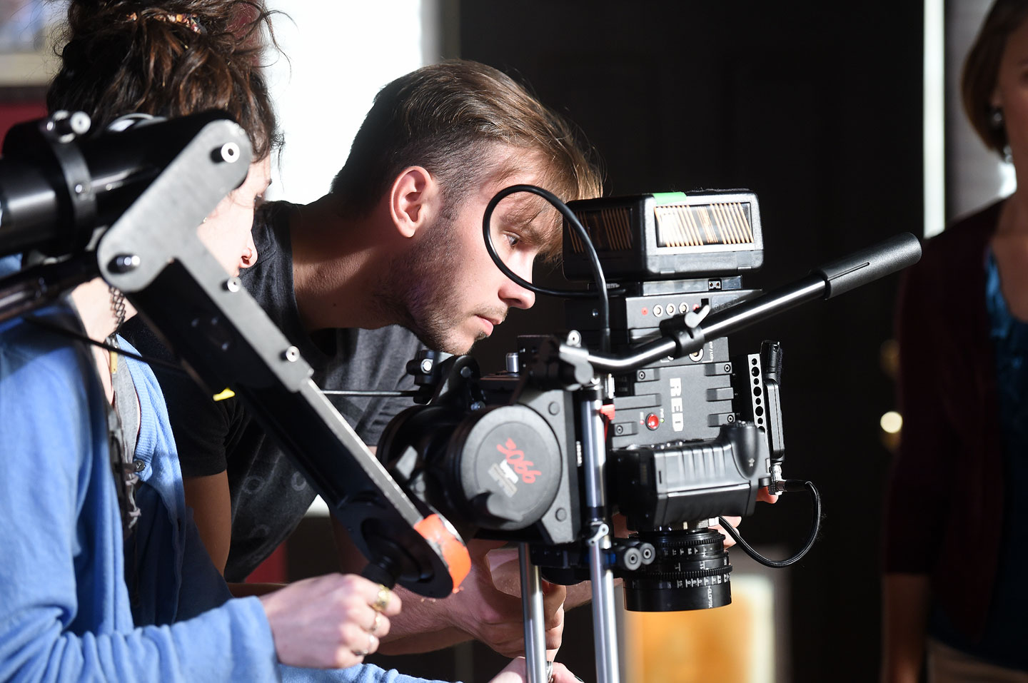 Filmmaking students on set with camera