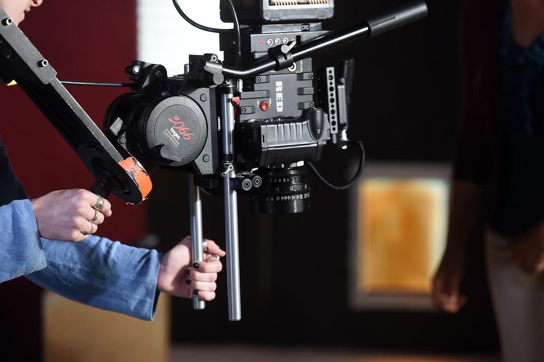 Film student operates RED camera