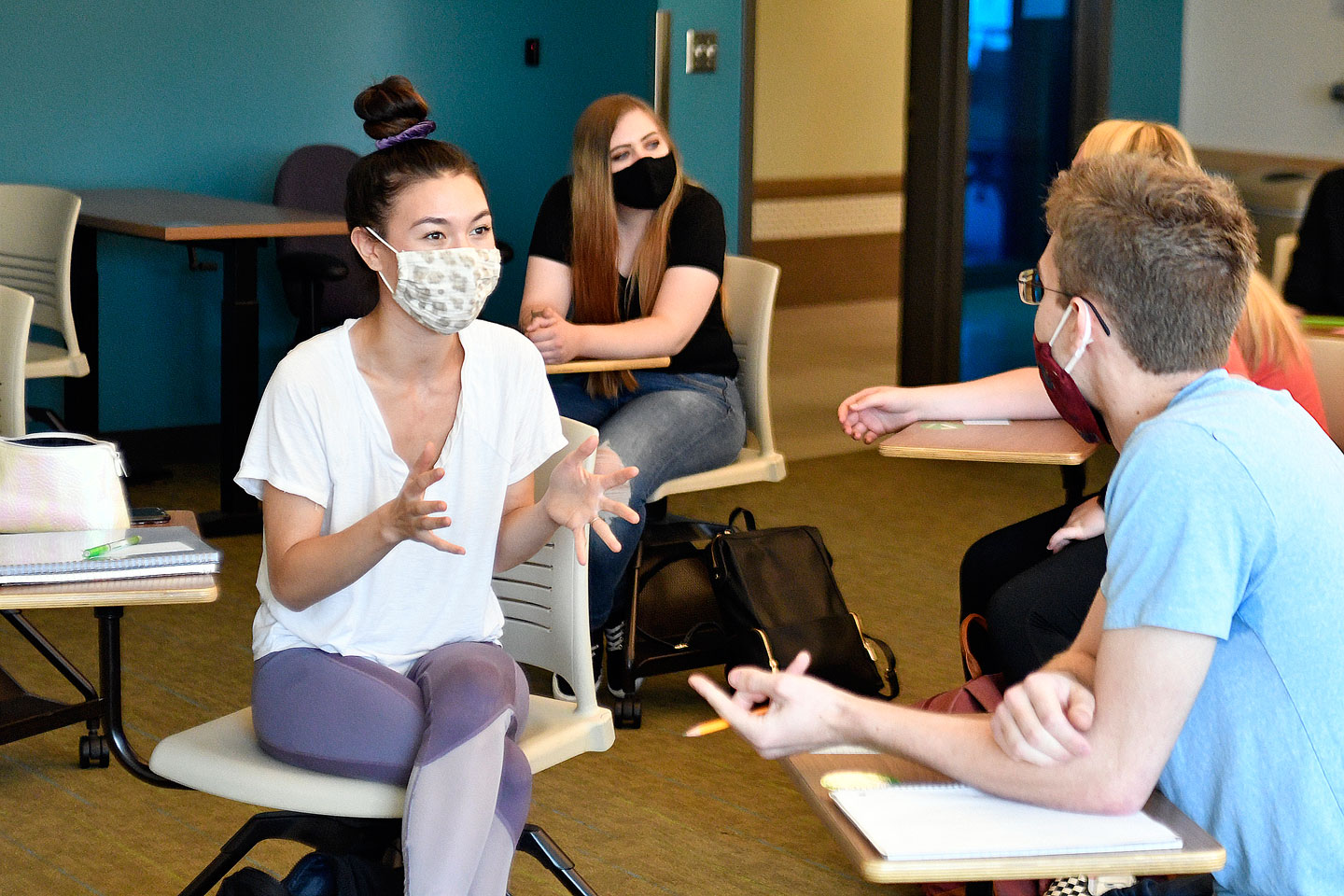 Students talking while wearing masks