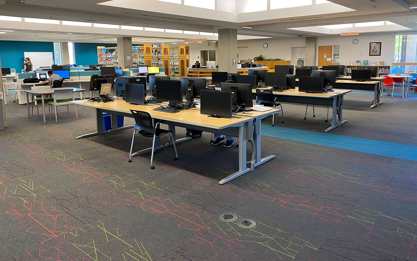 Computer stations with reduced seating in Markosian Library