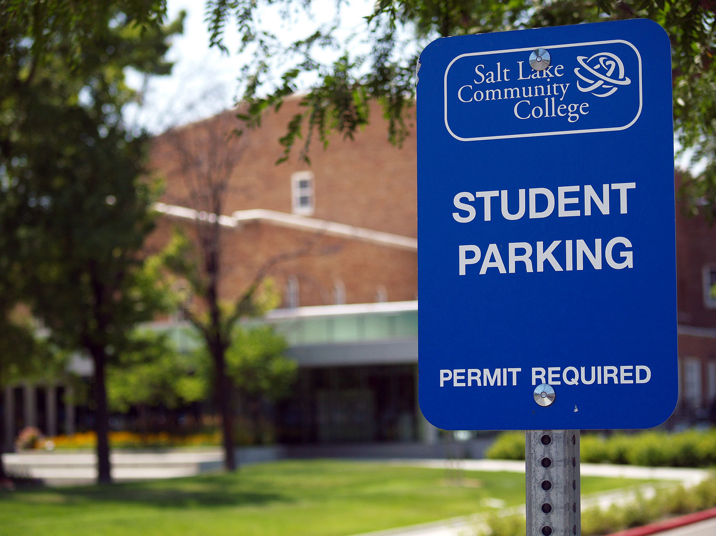"Blue Salt Lake Community College sign reads ""Student Parking, Permit Required"""