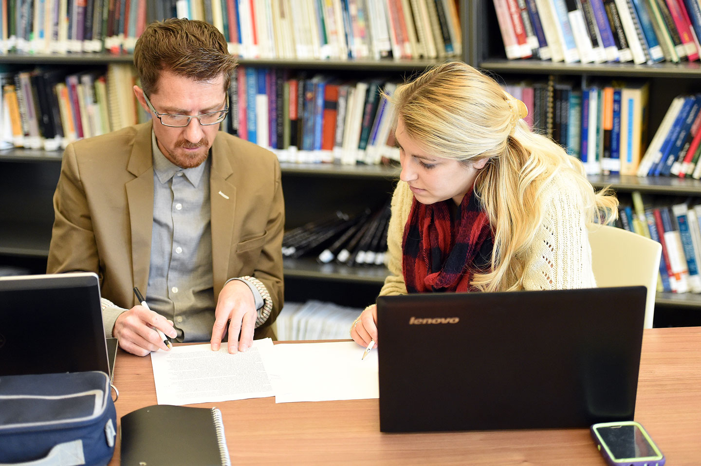 Writing Center tutor advises a student